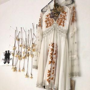 white beaded mid length dress